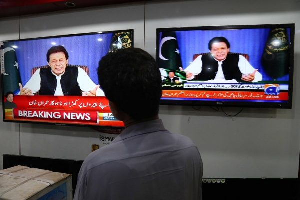 epa06959128 A man watches the televised address to the Nation of Pakistan's Prime Minister Imran Khan on a television in Karachi, Pakistan, 19 August 2018. Imran Khan held his first address to the nation after forming a government following 25 July general elections.Imran Khan was sworn in as the 22nd prime minister of Pakistan on Saturday at a ceremony in Islamabad, attended by the country's top officials and his former cricket colleagues.  EPA/SHAHZAIB AKBER